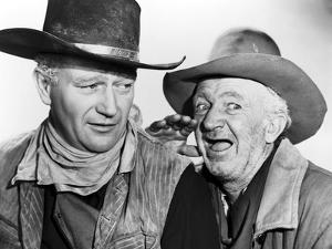 RED RIVER, 1948 directed by HOWARD HAWKS John Wayne and Walter Brennan (b/w photo)