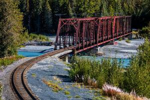 Red Rod Iron Railroad Bridge traverses Alaskan river, Alaska