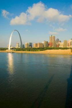 """Reflection on Gateway Arch (""""Gateway to the West"""") and skyline of St. Louis, Missouri at sunrise..."""