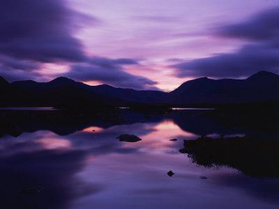 https://imgc.allpostersimages.com/img/posters/reflections-in-the-lake-of-sunset-over-dark-hills-of-rannoch-moor-highlands-scotland_u-L-P7XEA40.jpg?p=0