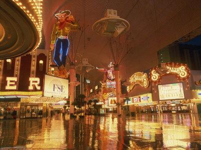 https://imgc.allpostersimages.com/img/posters/reflections-of-neon-lights-and-signs-along-fremont-street-in-las-vegas-nevada-usa_u-L-P7XGLO0.jpg?p=0