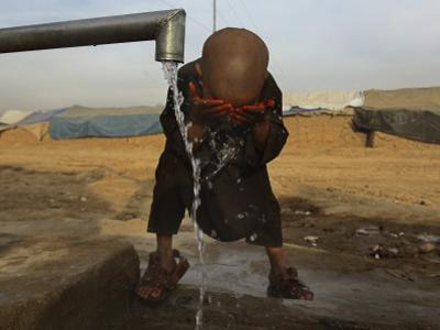 Refugee Washes His Face in a Refugee Camp in the Outskirts of Kabul, Afghanistan