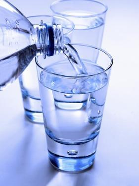 Pouring a Glass of Mineral Water by Regina Hippel