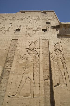 https://imgc.allpostersimages.com/img/posters/relief-depicting-horus-on-left-pylon-temple-of-horus-edfu-egypt-north-africa-africa_u-L-PWFRPC0.jpg?p=0