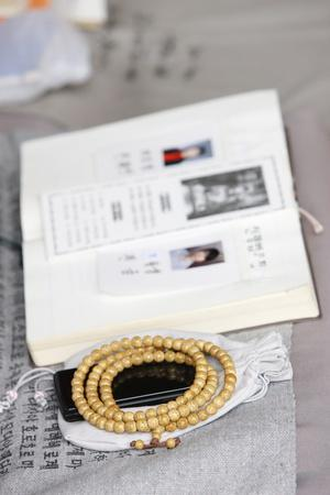 https://imgc.allpostersimages.com/img/posters/religious-book-prayer-beads-and-mobile-phone-seoul-south-korea_u-L-Q1GYLD00.jpg?artPerspective=n
