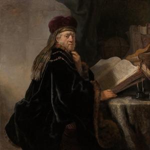 A Scholar Seated at a Desk (Scholar at His Stud) by Rembrandt van Rijn