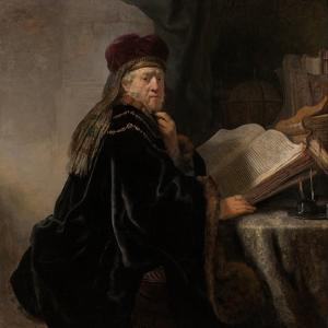 A Scholar Seated at a Desk (Scholar at His Stud) by Rembrandt van Rijn