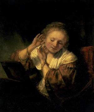 Young Woman Trying Earrings, 1654 by Rembrandt van Rijn