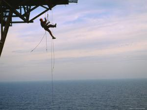 Remote Access Technicians Dangle off Ropes on an Oil Rig