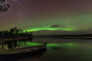 Northern Light or Aurora Borealis Nellim Near Inari Lake Lapland Finland by Renato Granieri
