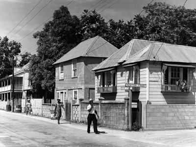 https://imgc.allpostersimages.com/img/posters/residential-street-in-kingston-c-1962_u-L-PPQVC10.jpg?p=0
