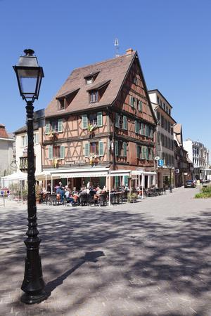 https://imgc.allpostersimages.com/img/posters/restaurant-in-a-half-timbered-house-colmar-alsace-france-europe_u-L-PWFS5O0.jpg?artPerspective=n