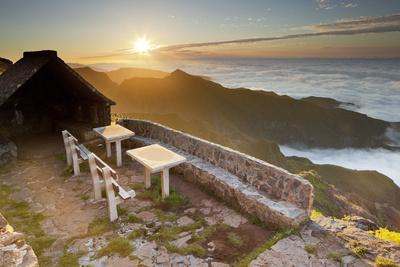https://imgc.allpostersimages.com/img/posters/resting-place-near-terxeira-stone-bank-sunset-madeira-portugal_u-L-Q11YN2C0.jpg?artPerspective=n