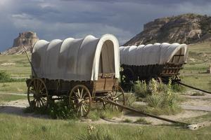 Restored Covered Wagons (Conestoga Wagon at Rear), at Scotts Bluff on the Oregon Trail in Nebraska