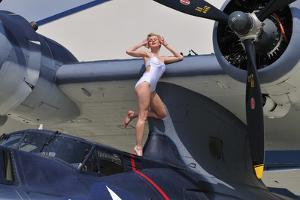 Retro Pin-Up Girl Posing with a World War II Era Pby Catalina Seaplane