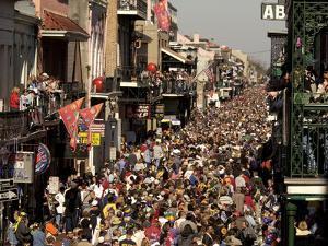 Revelers Pack the French Quarter's Famous Bourbon Street During the Annual Mardi Gras Celebration