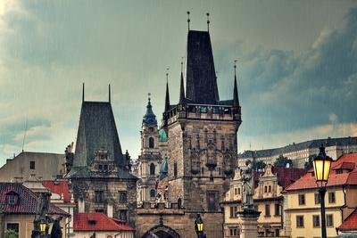 Old Medieval Tower and Sculptures on Famous Charles Bridge in Prague, Czech Republic.