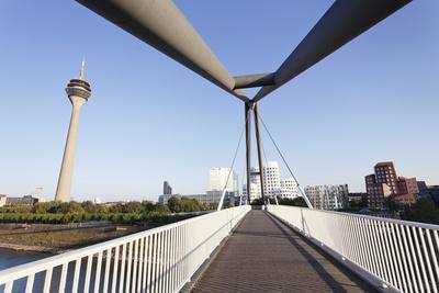 https://imgc.allpostersimages.com/img/posters/rheinturm-tower-and-frank-gehry-buildings-at-media-harbour-medienhafen_u-L-PNFYWD0.jpg?artPerspective=n