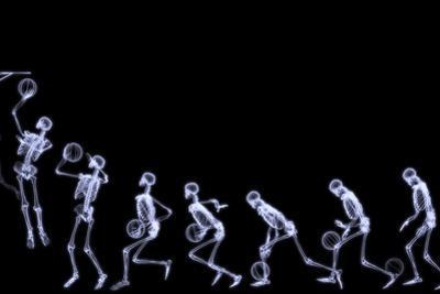 Xray of Human Skeleton Playing Basketball by riccardocova