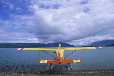 A Colorful Seaplane Docked on Naknek Lake by Rich Reid