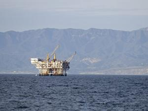 Oil Rig in the Santa Barbara Channel and the Santa Ynez Mountains, California by Rich Reid