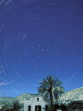 Startrails Around the Polaris and Full Moon by Rich Reid