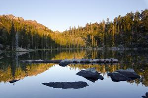 Sunrise on the Sierra Buttes Reflecting in Volcano Lake by Rich Reid