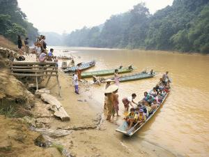 Longboat Crowded with Children Leaving for Week at School, Katibas River, Island of Borneo by Richard Ashworth