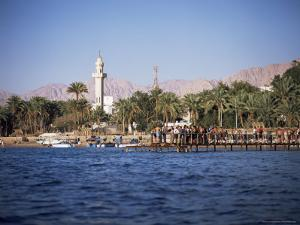 Youths Swimming from Jetty, Town Beach, Aqaba, Jordan, Middle East by Richard Ashworth