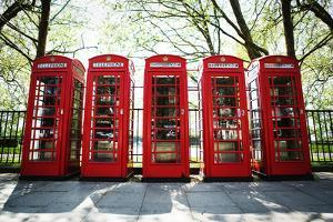 Five Red Telephone Boxes in a Line, London by Richard Boll