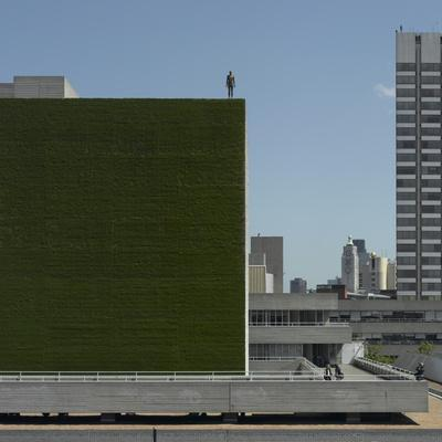 Living Wall, on National Theatre, Southwark, London. Figures, Event Horizon, by Antony Gormley