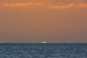 Green Flash after Sunset from Kamalo Wharf, Molokai, Hawaii by Richard Cooke III