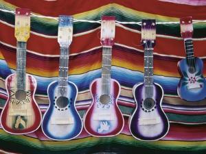 Colorful Guitars Drying by Richard Cummins
