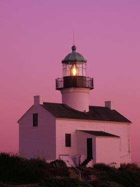 Lighthouse Against a Pink Sky at Twilight by Richard Cummins