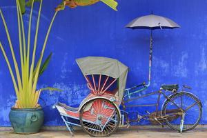 Rickshaw in Cheong Fatt Tze Mansion, Georgetown, Penang Island, Malaysia, Southeast Asia, Asia by Richard Cummins
