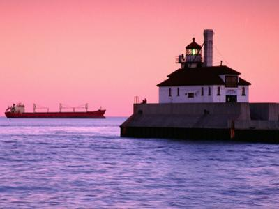 South Breakwater Outer Lighthouse at Dawn, with Ship on Horizon, Duluth Harbor, Duluth, USA by Richard Cummins
