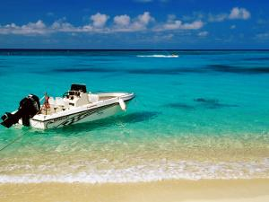 Speedboat Moored at Conroy Beach, Montego Bay, St. James, Jamaica by Richard Cummins