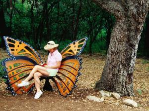 Woman Sitting in Butterfly Chair at Botanical Gardens, Zilker Park, Austin, Texas by Richard Cummins