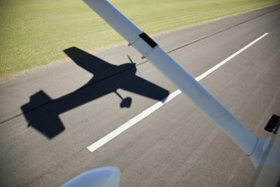 A Cessna Light Aircraft Taking Off. the Shadow Tells the Story. by Richard Du Toit