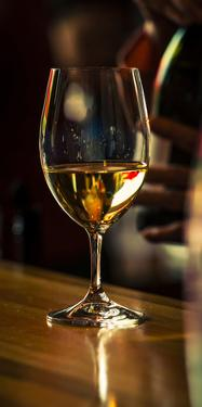 USA, Washington State, Woodinville. A glass of white wine and reflections by Richard Duval