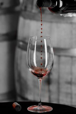 USA, Washington Woodinville. Red wine pouring into is captured in mid-air