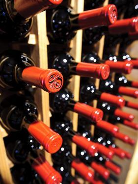 Wine Bottles in a Rack, Temecula, California, USA by Richard Duval