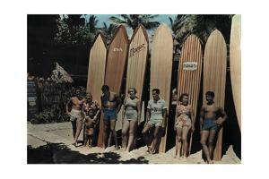 A Group of Surfers on Waikiki Beach Pose Leaning Against their Boards by Richard Hewitt Stewart