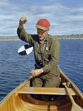 Marine Biologist Prepares a Secchi Disc to Test Clarity of Lake Water by Richard Hewitt Stewart