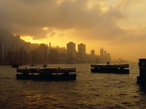 Ferries Silhouetted on the Harbour at Sunset, Hong Kong by Richard I'Anson