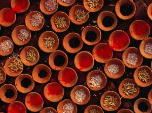Grains and Tika Powder for Sale for Offerings at Dasaswamedh Ghat, Varanasi, Uttar Pradesh, India by Richard I'Anson