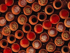 Grains and Tika Powder for Sale for Offerings at Dasaswamedh Ghat, Varanasi, Uttar Pradesh, India by Richard I'Anson