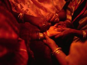 Hand of Bride Being Held by Female Relatives During Wedding Ceremony, India by Richard I'Anson