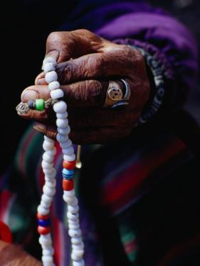 Loba Nomad Counting Prayer Beads, Yak Kharka,Kosi, Nepal by Richard I'Anson