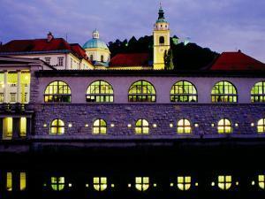 Plecnik Colonnade and Cathedral of St. Nicholas at Dusk, Ljubljana, Slovenia by Richard I'Anson